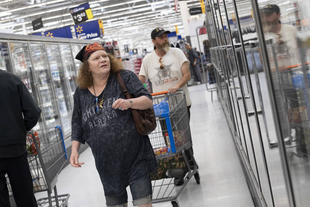 Debbie Holmgren and Todd Henke shop for food in the frozen section of Walmart on Saturday, Apri ...