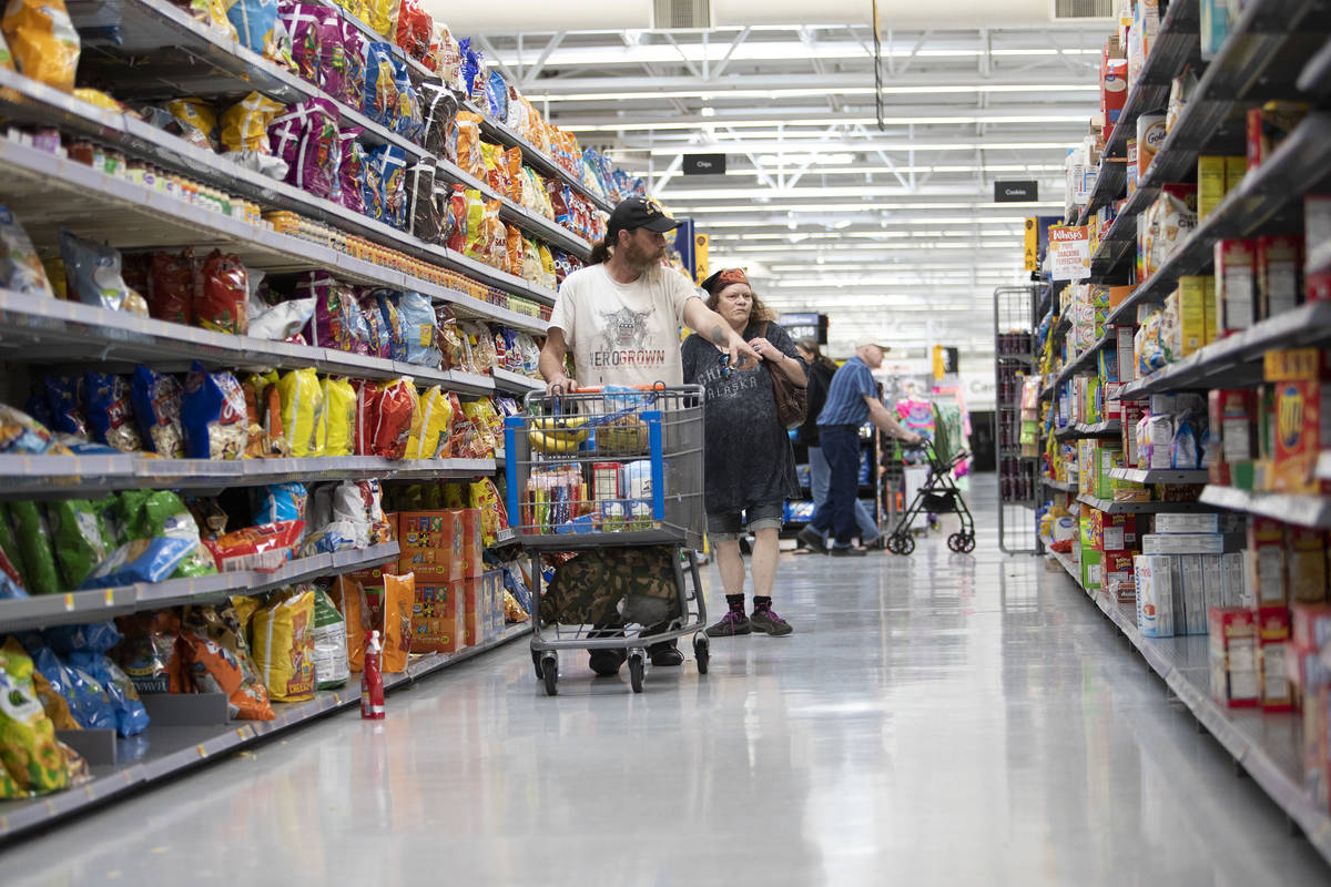 Debbie Holmgren and Todd Henke shop for food at Walmart on Saturday, April 4, 2020, in Bullhead ...