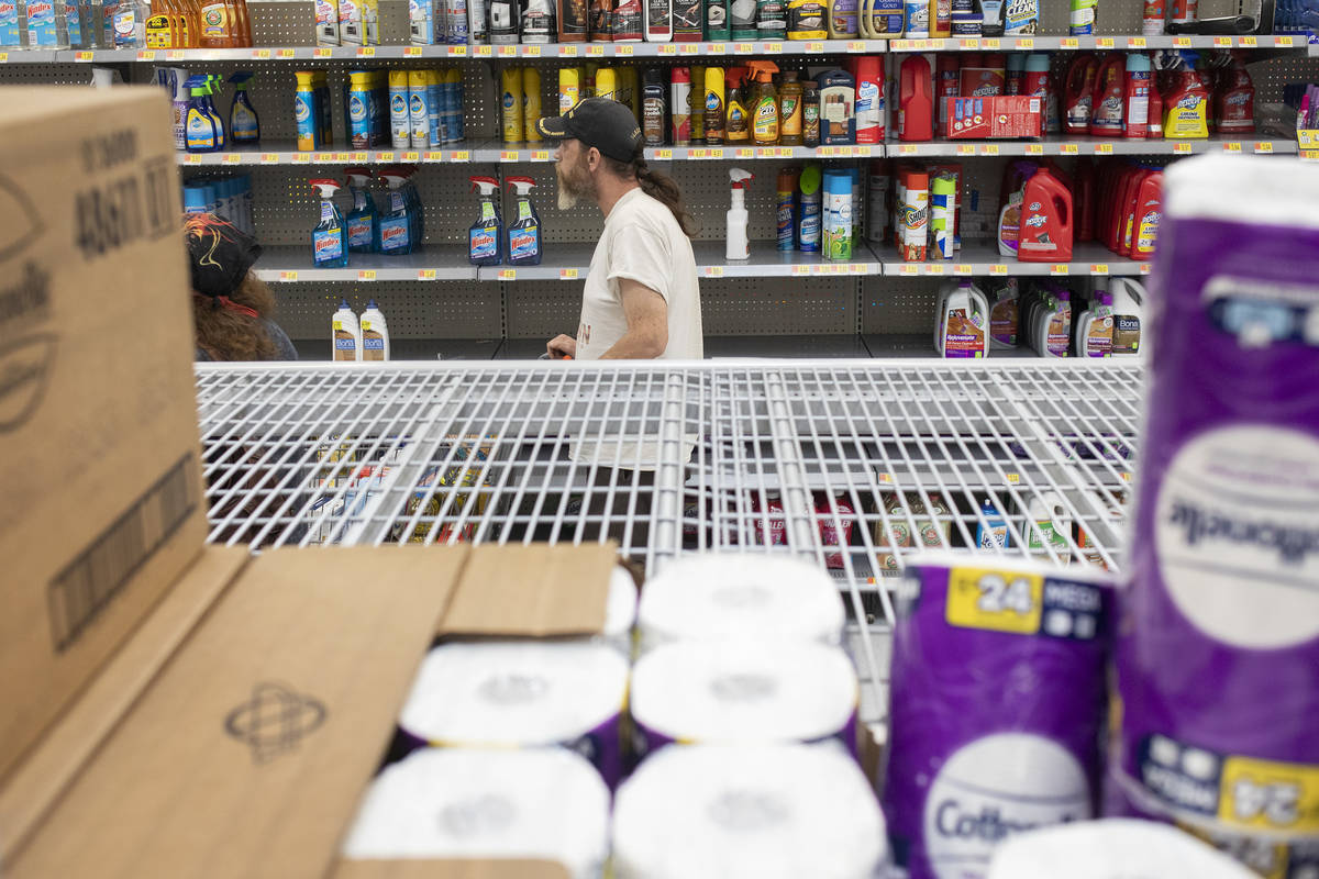 Todd Henke walks through the cleaning products aisle as just a few rolls of toilet paper are le ...