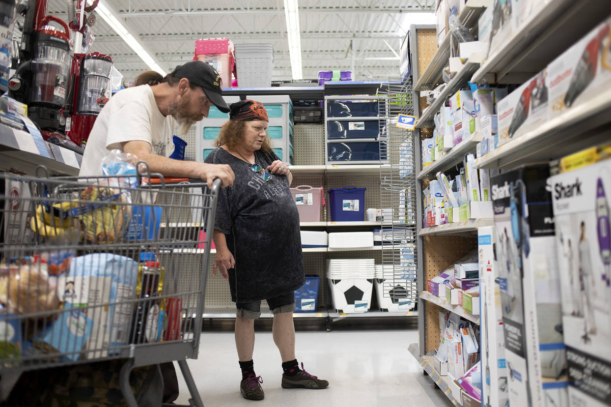 Todd Henke and Debbie Holmgren shop for vacuum cleaner bags, one of the items they weren't able ...