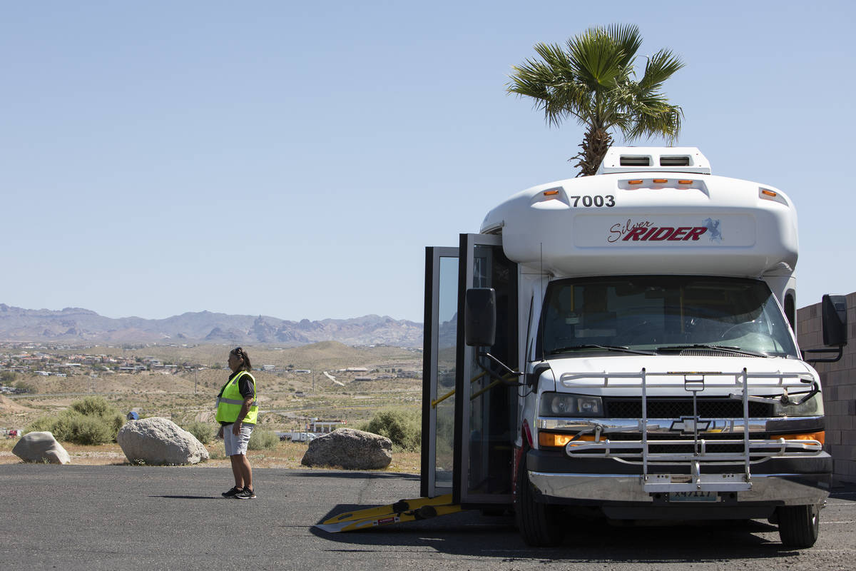 Bus driver Beverly Osko waits for passengers to arrive for a trip to the grocery store from Lau ...