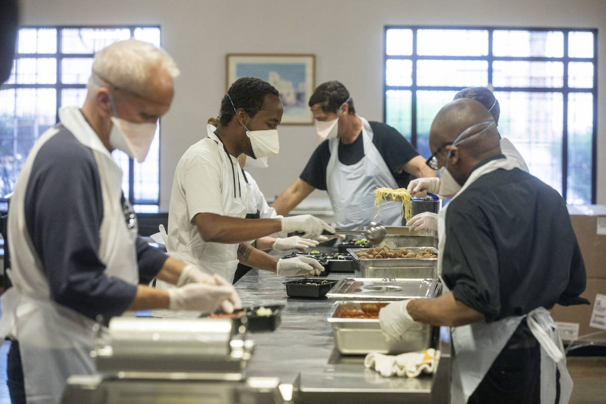 Individuals completing Catholic Charities of Southern Nevada's Renewing Hope program package di ...