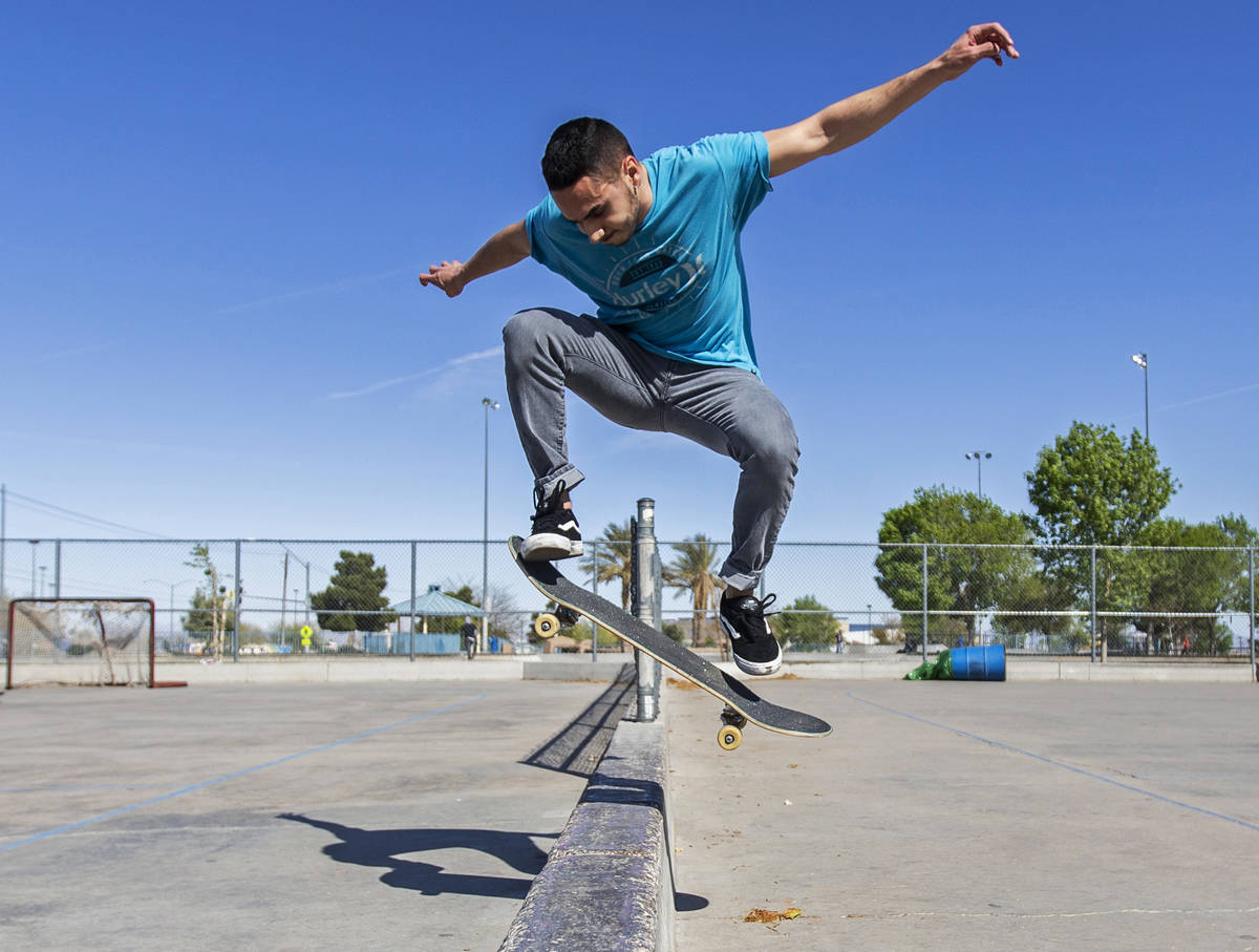 Tony Bitz does an ollie over a wall at Desert Breeze Park on Saturday, April 4, 2020, in Las Ve ...