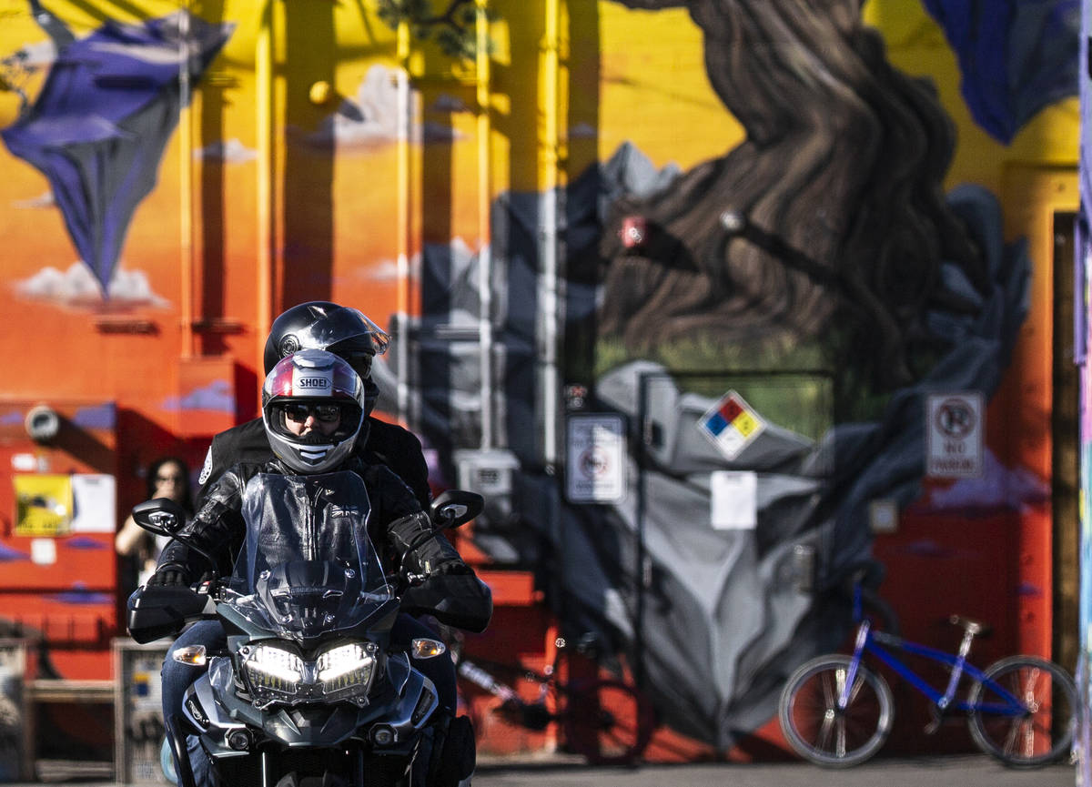A motorcyclist drives through an alley in the Arts District on Saturday, April 4, 2020, in Las ...