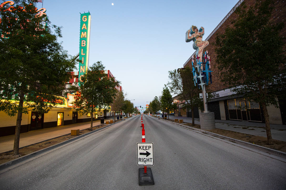 A view looking down Fremont East as traffic remains light in the wake of the closure of a stay- ...