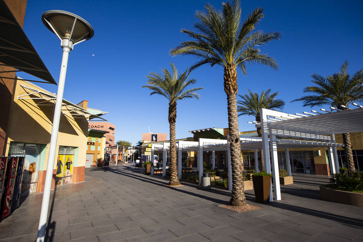 An empty Las Vegas North Premium Outlets as activity remains light in the wake of the closure o ...