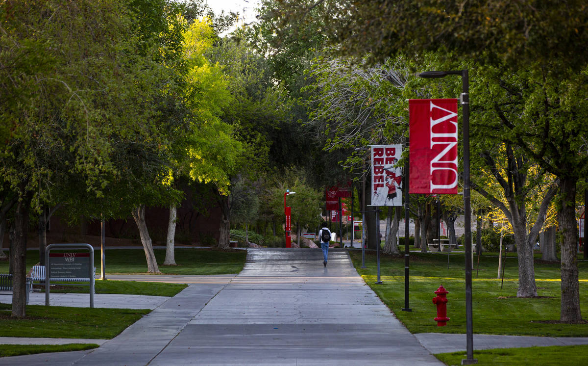 A man rides a scooter around UNLV as activity remains light in the wake of the closure of a sta ...