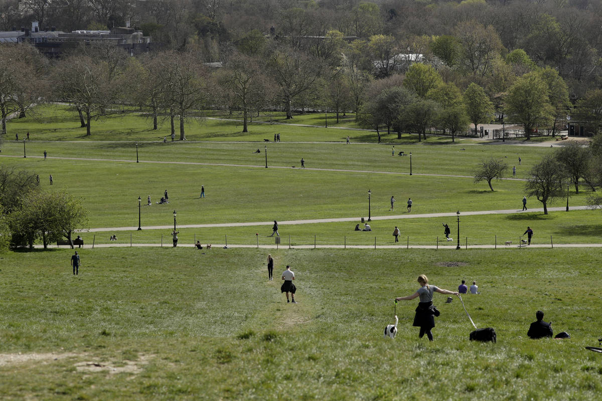People spread out as they observe social distancing on Primrose Hill in London, as London's par ...