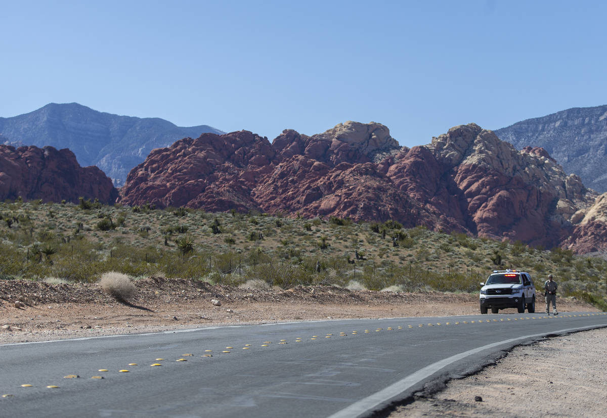 A Metro officer blocks off Calico Basin Road near Red Rock Canyon National Conservation Area on ...