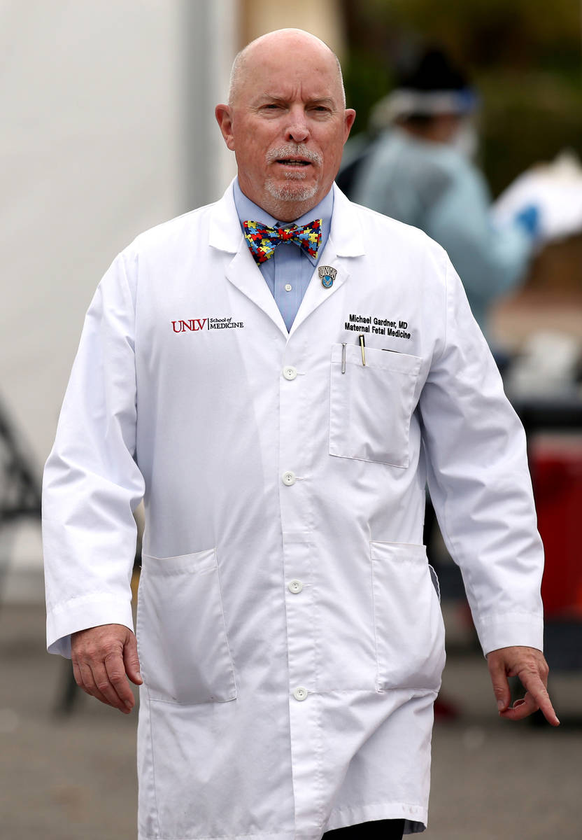 Dr. Michael Gardner, Vice Dean of Clinical Affairs at UNLV School of Medicine during curbside t ...
