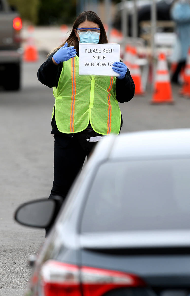 UNLV School of Medicine Certified Medical Assistants test curbside for COVID-19 at the school i ...