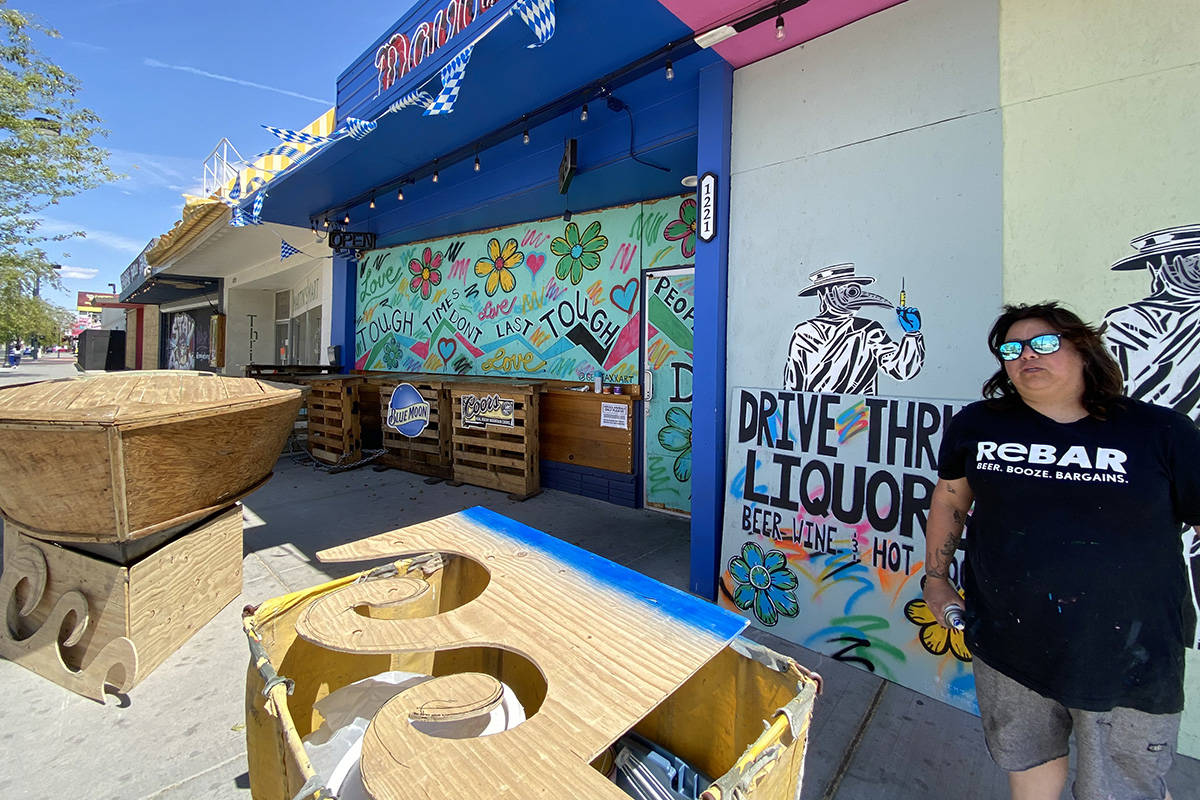 Geneva Marquez, art project director for Davy's at ReBar in downtown Las Vegas, preps for the o ...