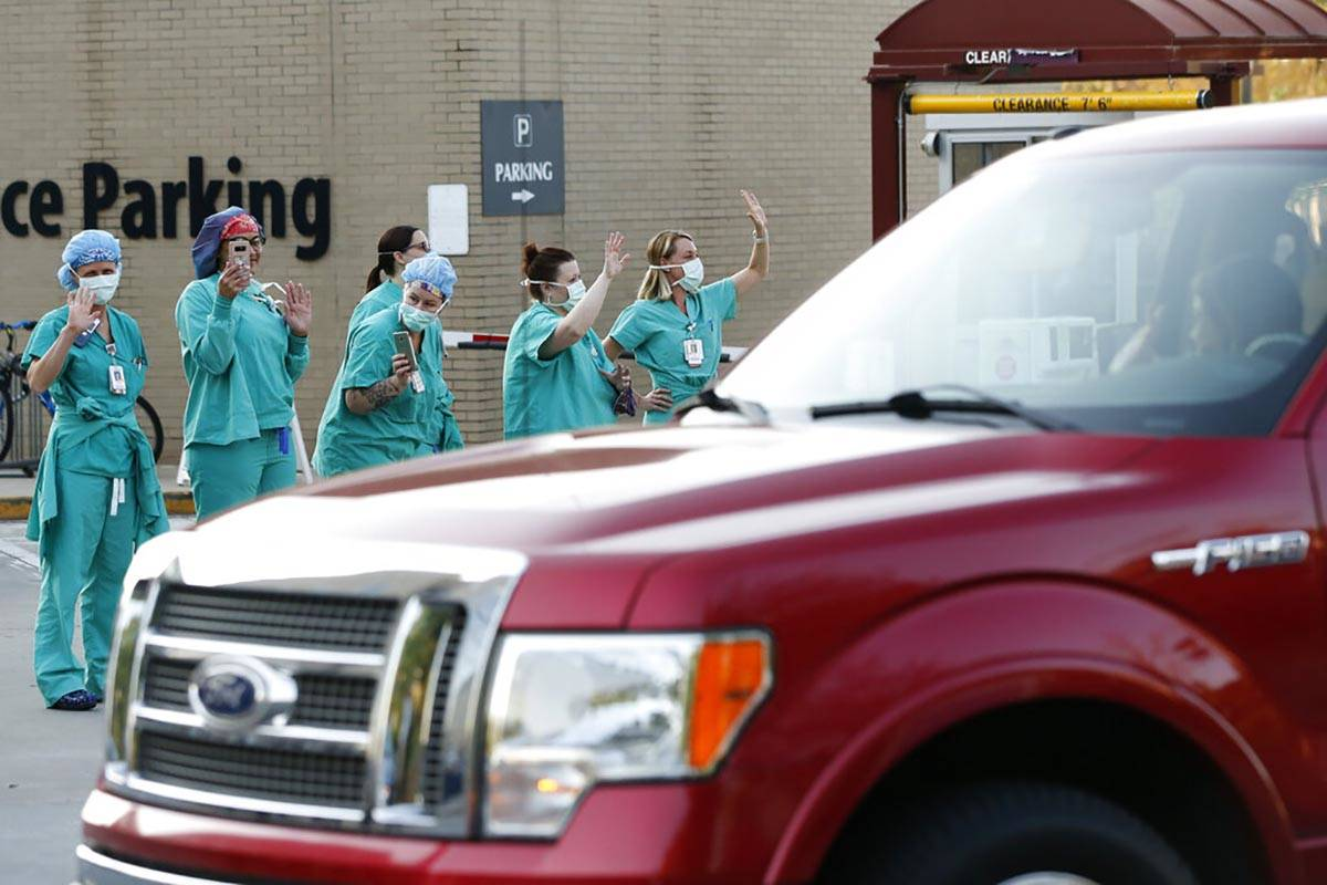 Piedmont Athens Regional Medical Center health care professionals stand and wave from the sidew ...