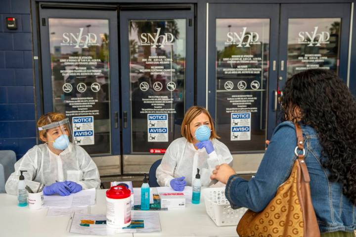 Southern Nevada Health District registered nurse Joanna Corpuz, left, and immunization clinic a ...