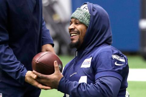 Seattle Seahawks running back Marshawn Lynch smiles during warmups at the NFL football team's p ...
