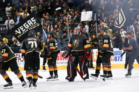 Golden Knights goaltender Robin Lehner (90) celebrates with his teammates after an NHL hockey g ...