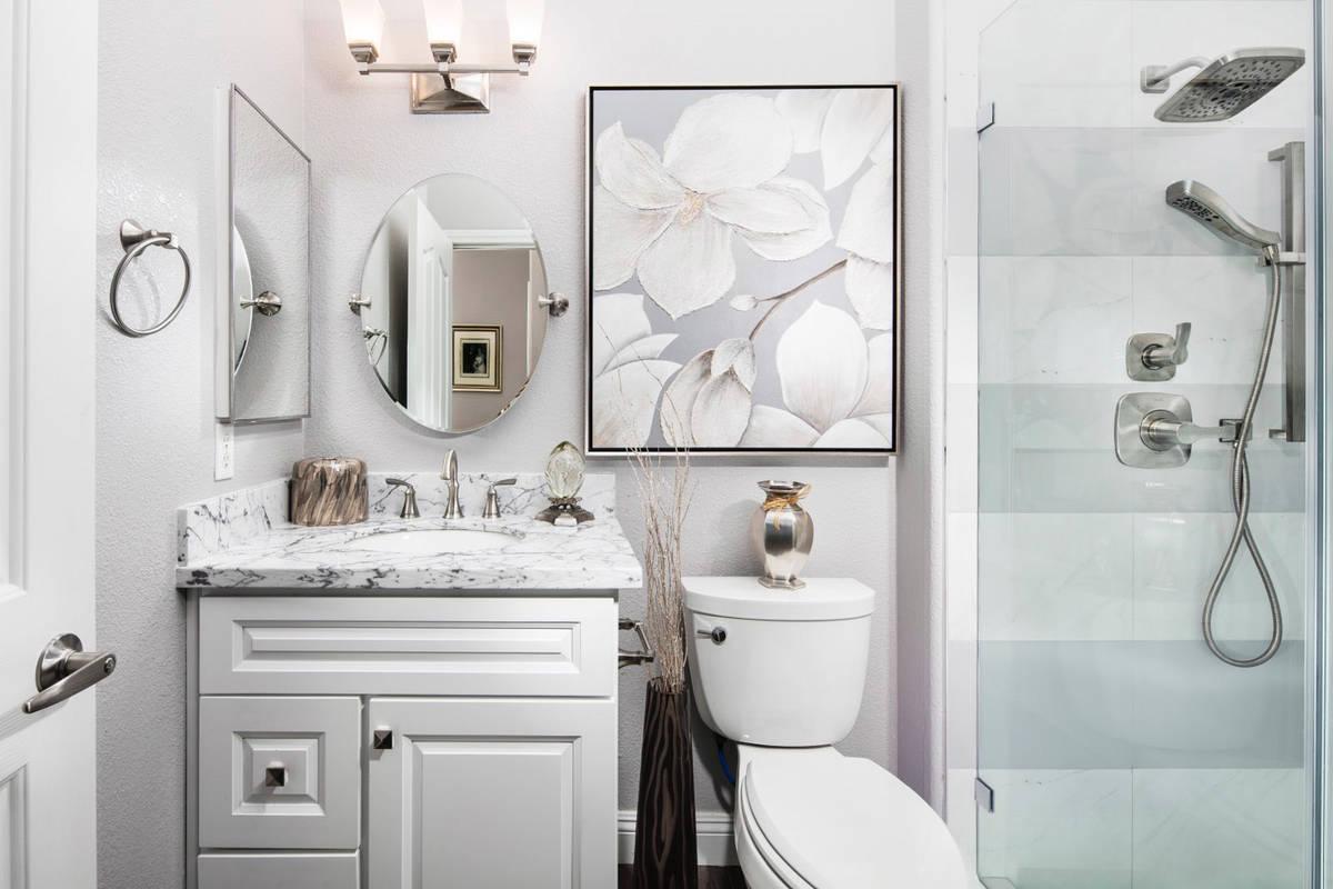 Interior designer Kimberly Joi McDonald incorporated this original floral wall art from LeftBan ...