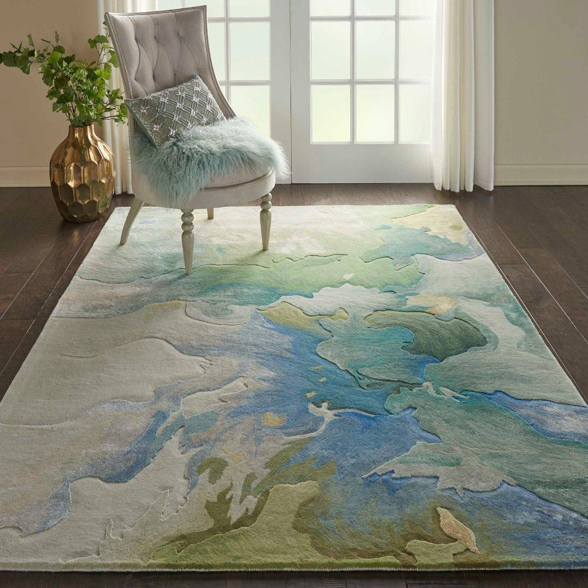 This Prismatic rug from Nourison features a 3D-like design and captivating floral color palette ...