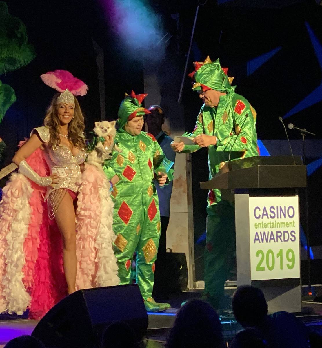 Jade Simone, Piff the Magic Dragon and Penn Jillette are shown as Piff accepts his Casino Comed ...