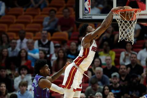Miami Heat forward Derrick Jones Jr. dunks the ball against Charlotte Hornets forward Jalen McD ...
