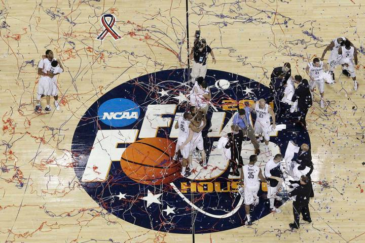 Connecticut celebrates after winning the men's NCAA Final Four college basketball championship ...
