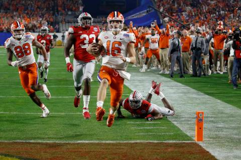 Clemson quarterback Trevor Lawrence runs in for a touchdown against Ohio State during the first ...