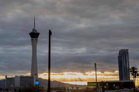 The sun peeks through gray clouds in Las Vegas on Tuesday, April 7, 2020. Rain is expected in t ...