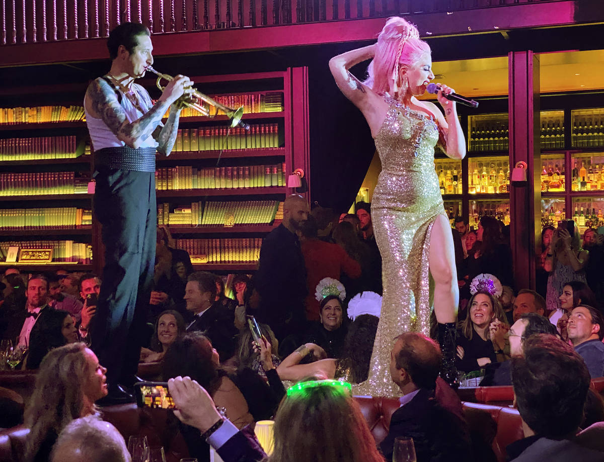 Brian Newman and Lady Gaga perform at NoMad Restaurant at Park MGM on the Strip on New Year's D ...