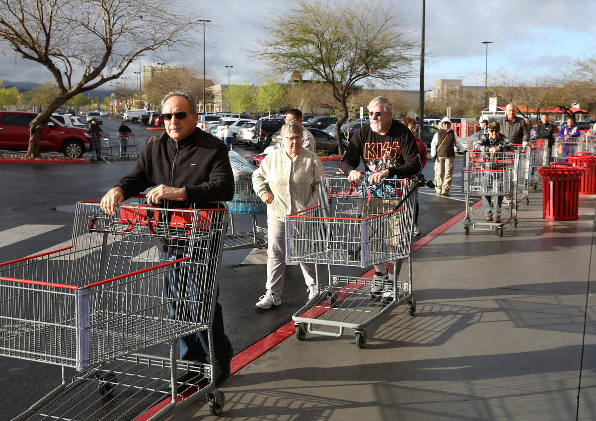 Seniors line up outside Costco on Friday, March 20, 2020, in Henderson. The store reserved earl ...