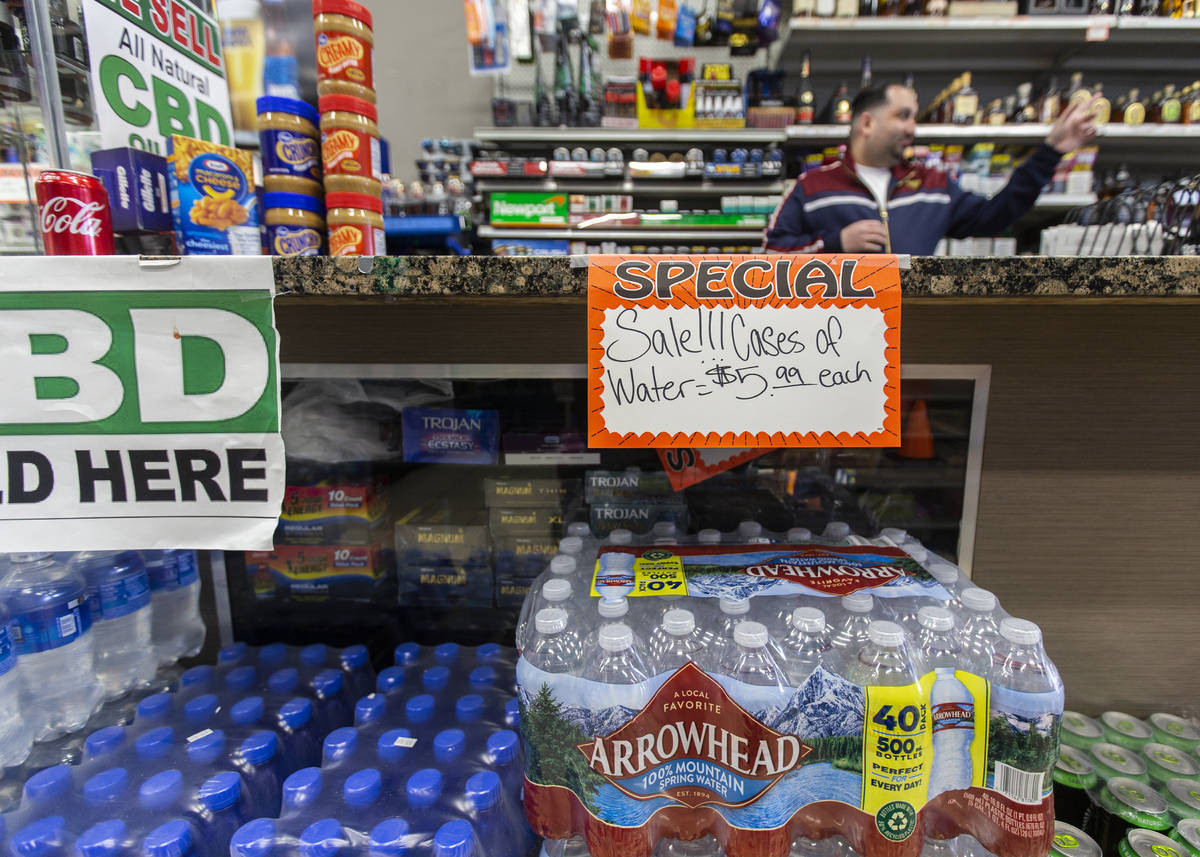 Cases of water at Liquor Emporium on Tuesday, April 7, 2020, in Las Vegas. The business just re ...