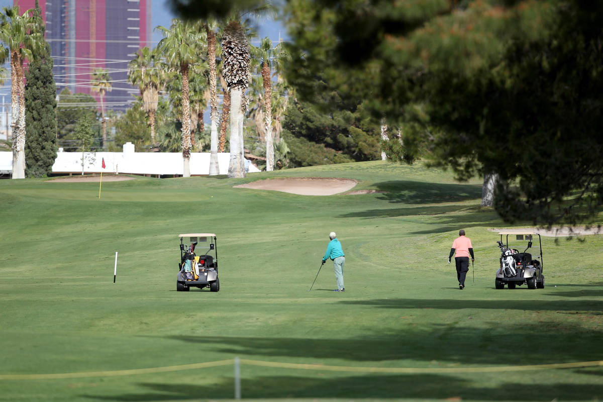 Golfers at Las Vegas National Golf Club Wednesday, April 8, 2020. Golf courses have closed club ...