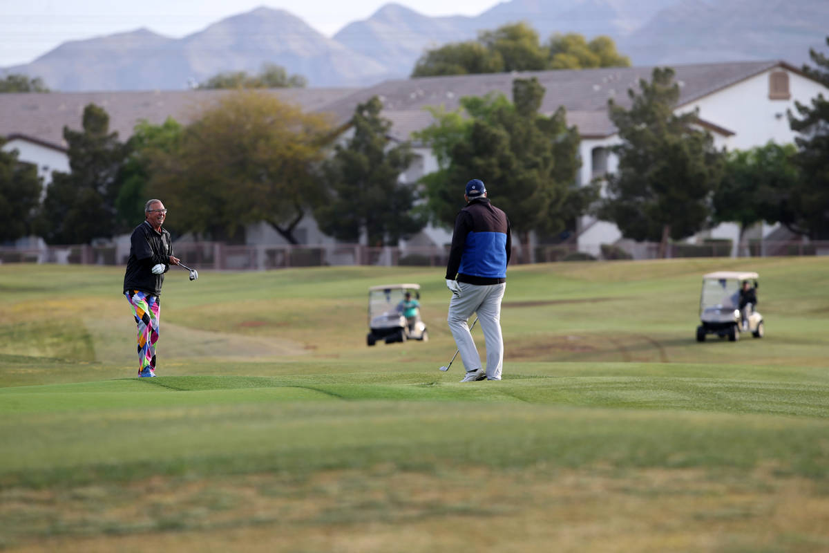 Golfers at The Club at Sunrise Wednesday, April 8, 2020. Golf courses have closed clubhouses an ...