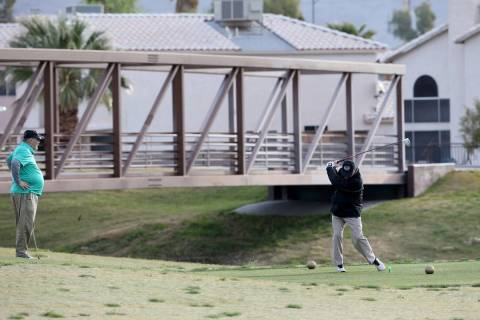 Golfers at The Club at Sunrise in Las Vegas Wednesday, April 8, 2020. Golf courses have closed ...