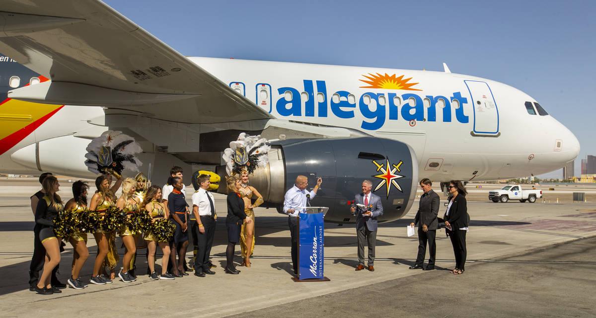 Allegiant Travel Co. chief marketing officer Scott DeAngelo offers a toast as Allegiant unveils ...
