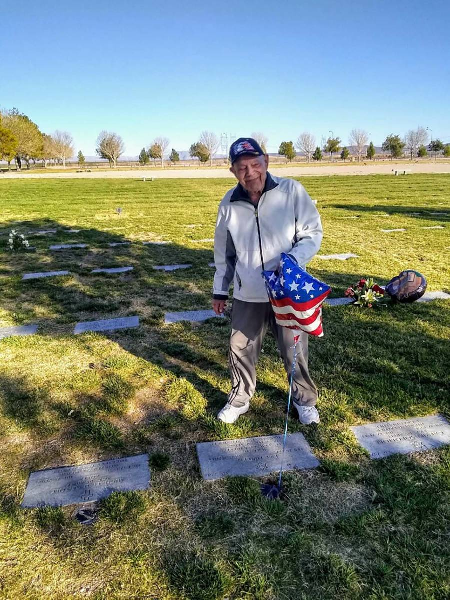 A February 2020 photo of WWII Army veteran Edward Turken, 96, visiting his wife Eva's grave at ...