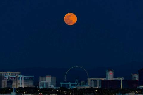 A pink supermoon rises over the Las Vegas Strip on Tuesday, April 7, 2020. (Benjamin Hager/Las ...