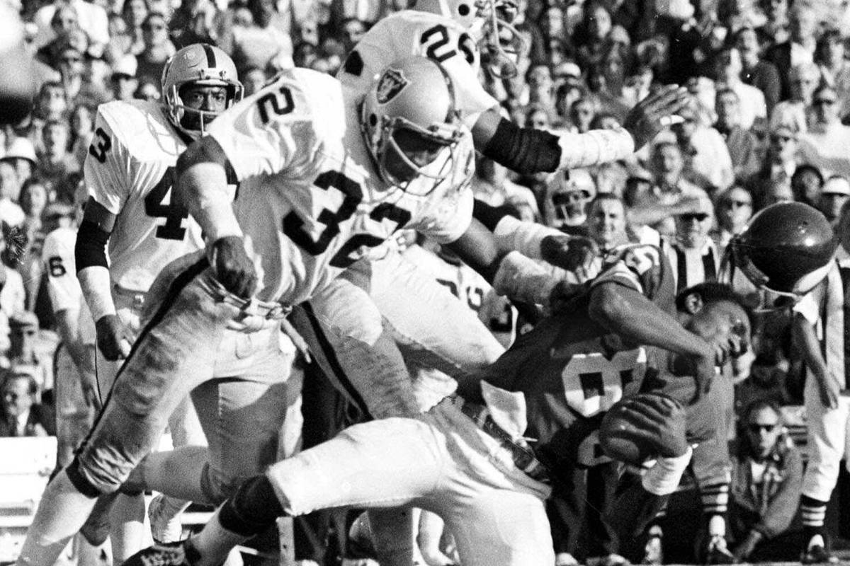 This Jan. 9, 1977 file photo shows Minnesota Vikings wide receiver Sammy White losing his helme ...