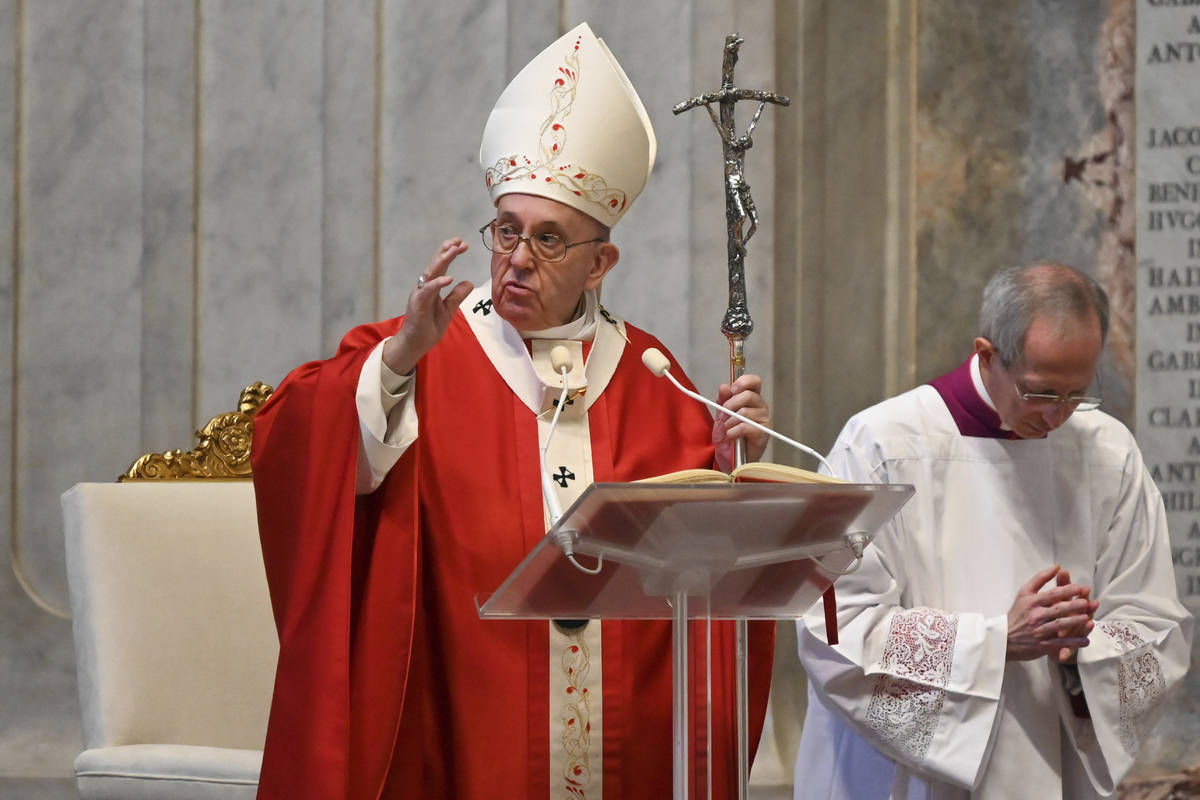 Pope Francis celebrates Palm Sunday Mass behind closed doors in St. Peter's Basilica, at the Va ...
