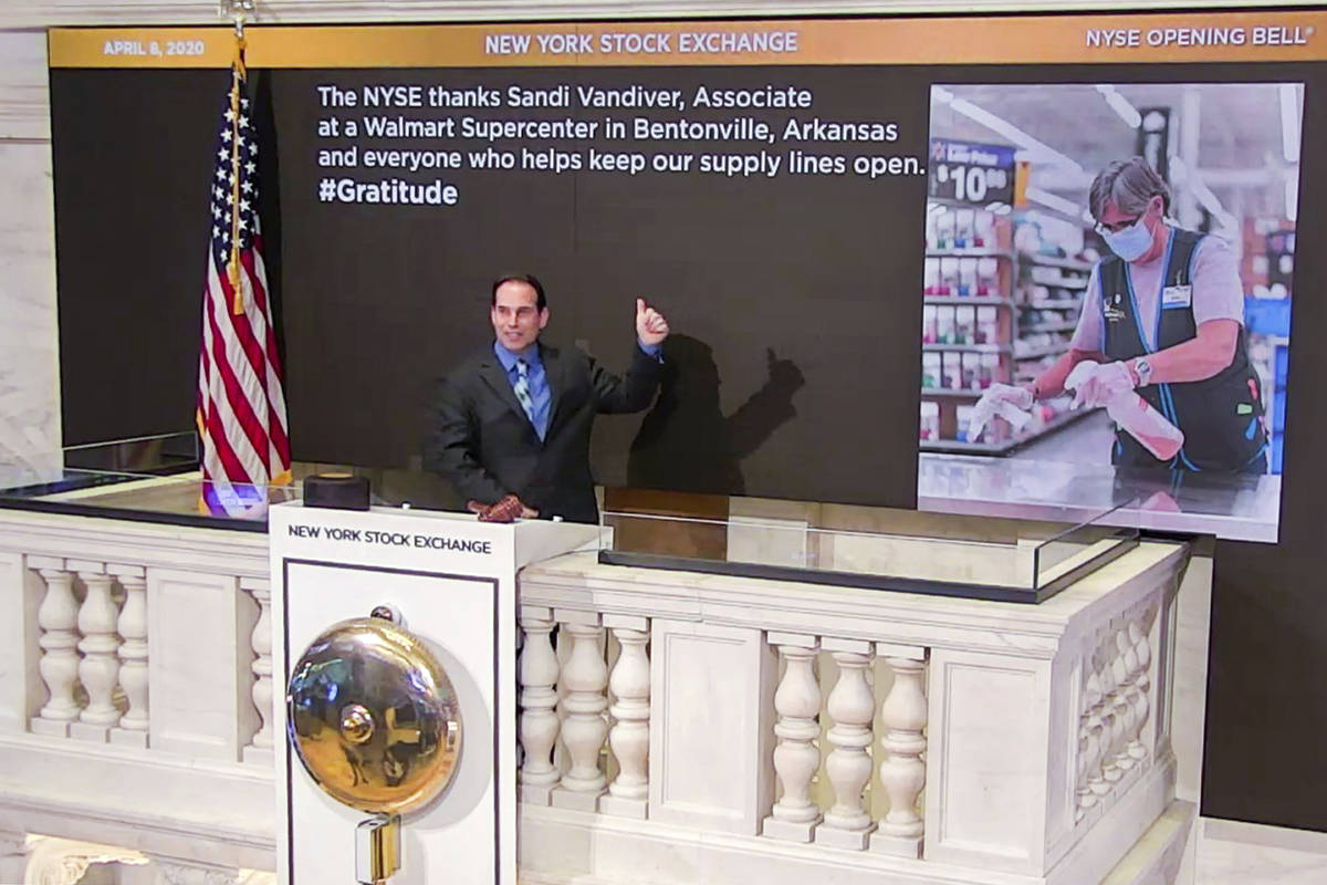 In this photo taken from video provided by the New York Stock Exchange, Kevin McSpedon, Assista ...