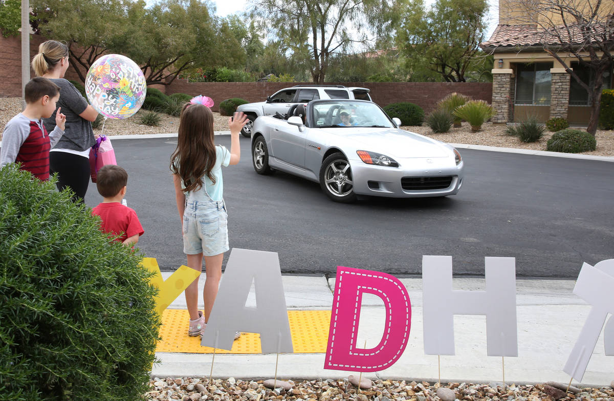 Tenley Hynds, right, waves to her friends and cousins who came to celebrate her 8th birthday wh ...