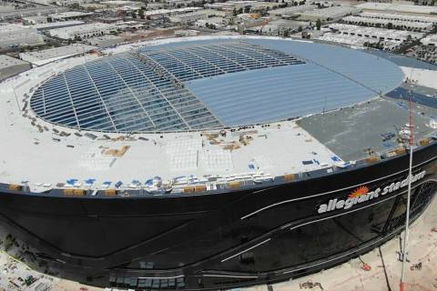 Crews installing roof panels at Allegiant Stadium on April 1, 2020. (Micheal Quine/ Las Vegas R ...