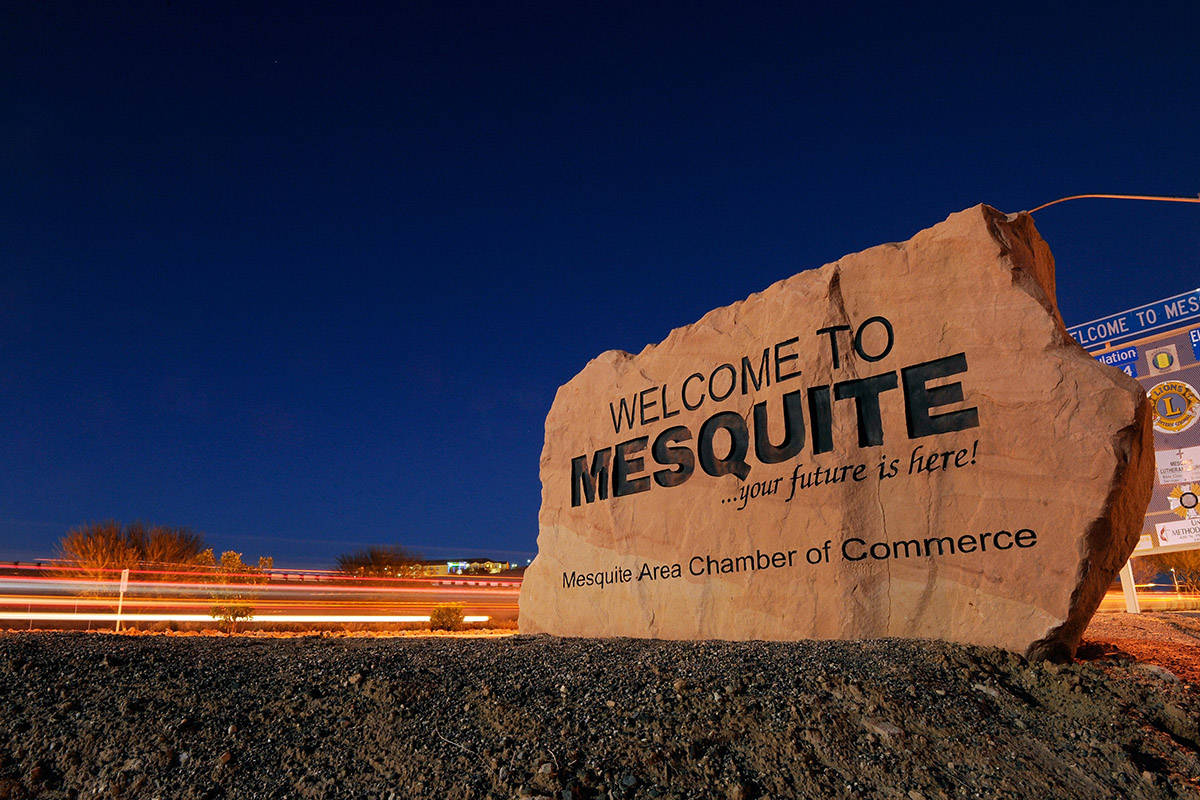 """Car lights streak by in front of the """"Welcome to Mesquite"""" sign (Las Vegas Review-Journal/file)"""