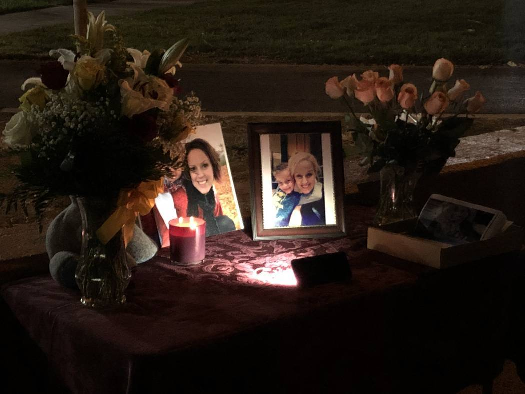 Pictures and flowers were lined up Oct. 15, 2019, during a vigil for 47-year-old Renai Palmer a ...