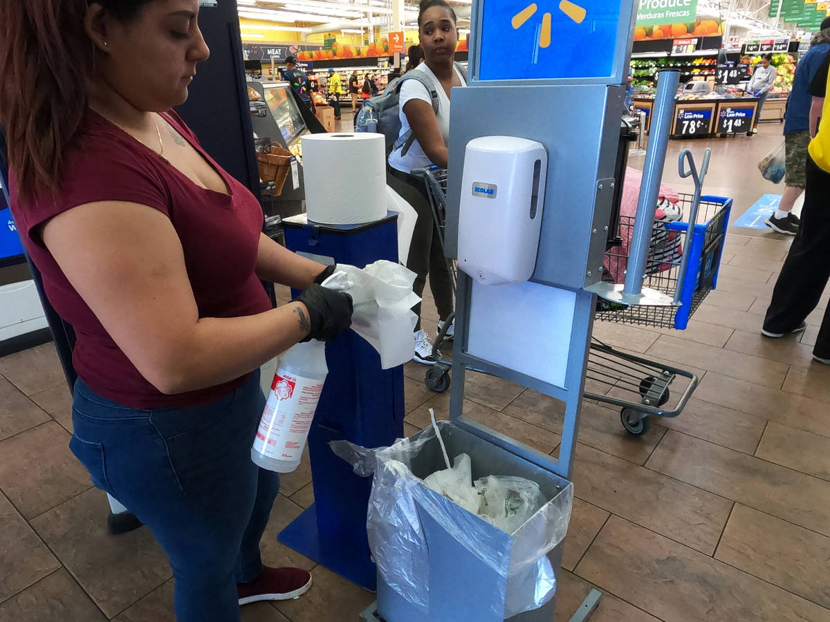 Sanitizing supplies are using by shoppers entering the Walmart Supercenter, 3950 W Lake Mead Bo ...
