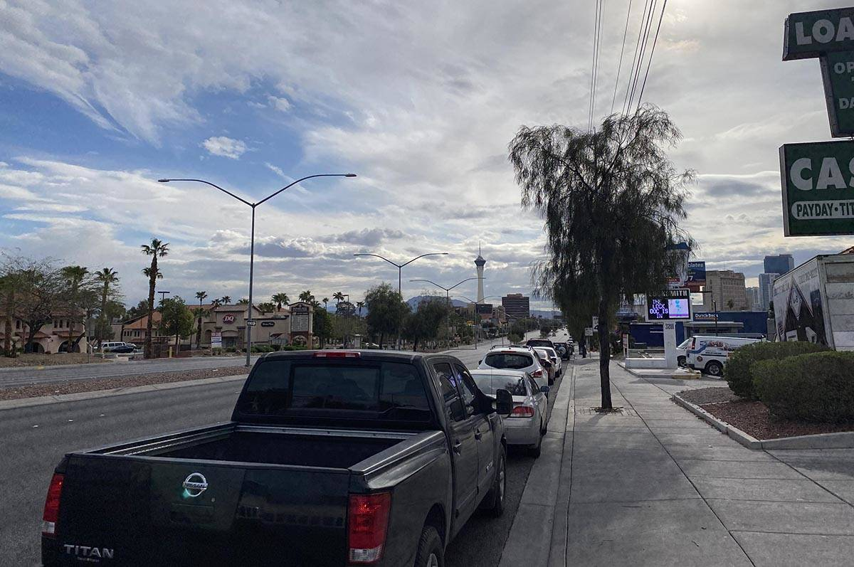 A line of cars estimated at several miles long line West Sahara Avenue as occupants wait for fo ...