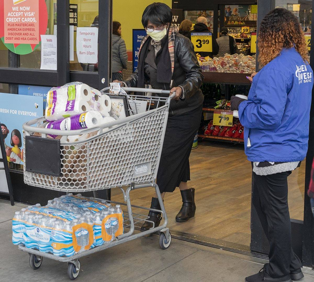Terry Arthur, 71, of Las Vegas, exits with the limited amount of water and toilet paper per hou ...