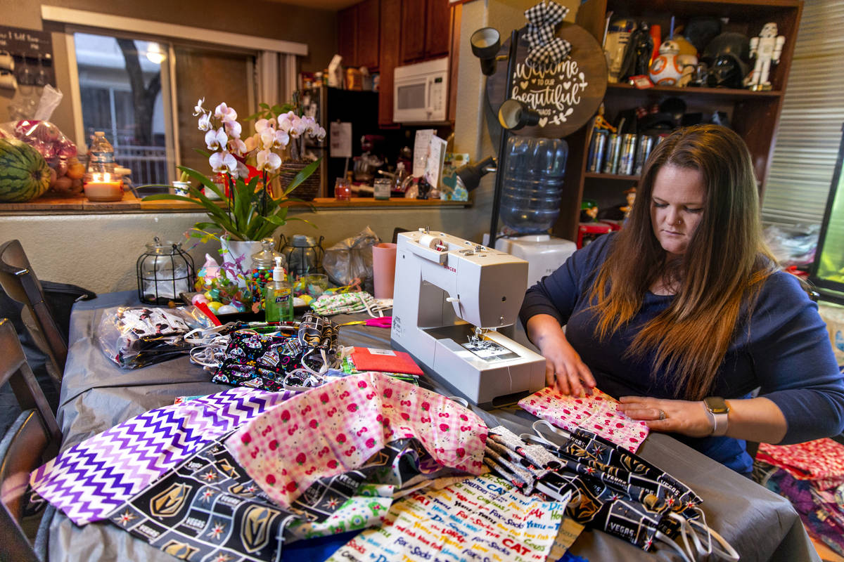 Chrissy Burley-Evans spends the evenings sewing more decorative cotton face masks as part of he ...
