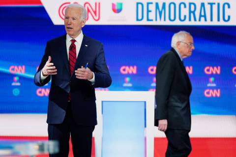FILE - In this March 15, 2020, file photo, former Vice President Joe Biden prepares for a Democ ...