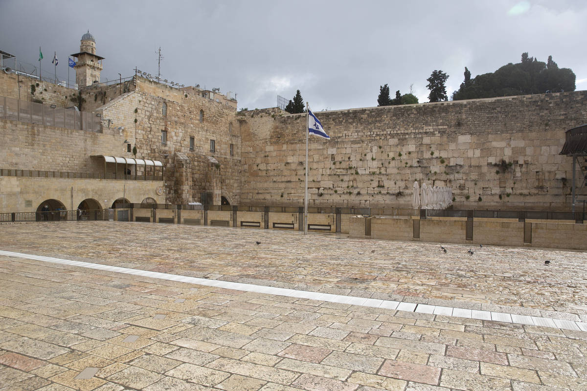 The Western Wall, the holiest site where Jews can pray, in Jerusalem's Old City, is empty Frida ...