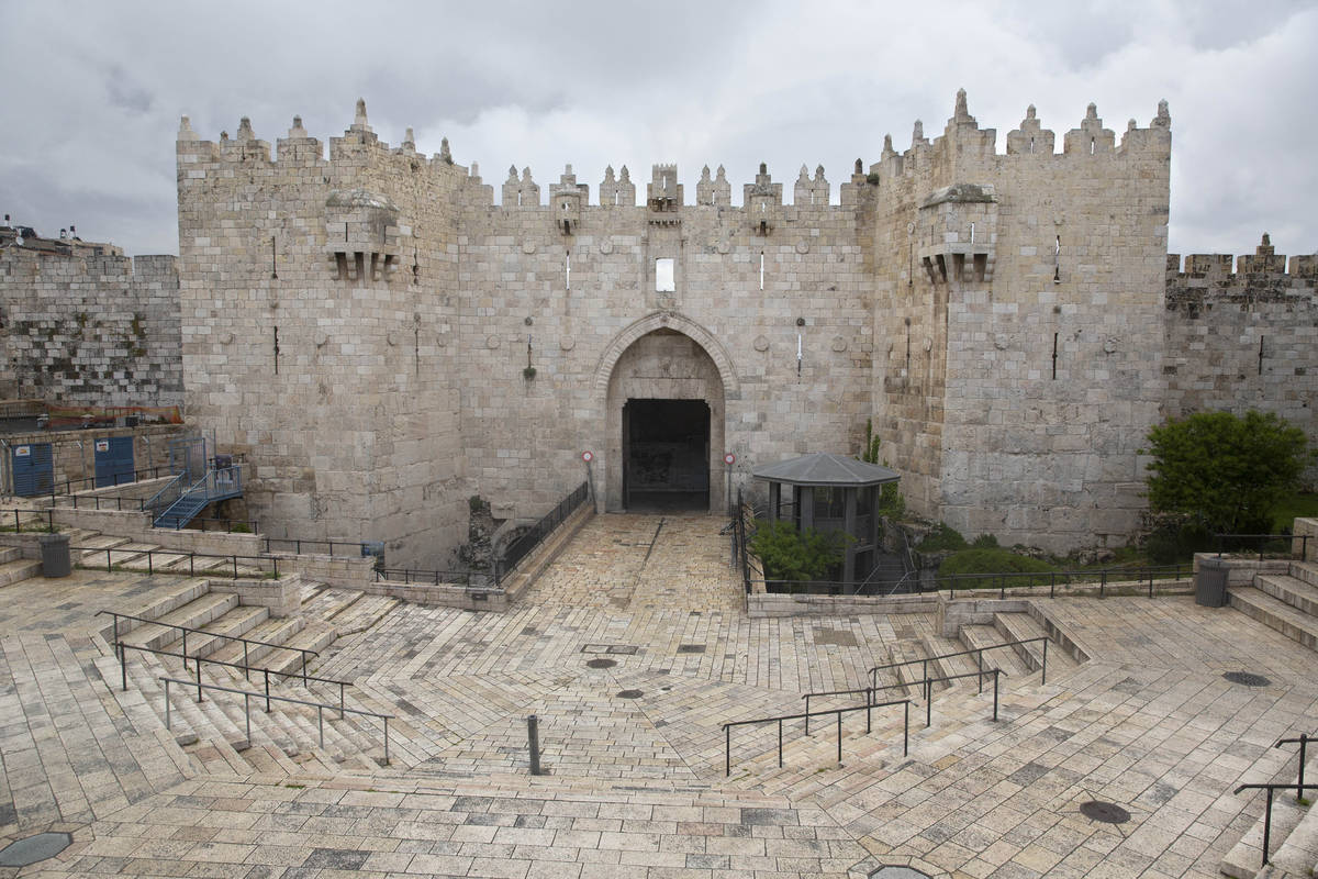 The Damascus Gate sits empty in Jerusalem's old city, Friday, April 10, 2020. Christians are co ...